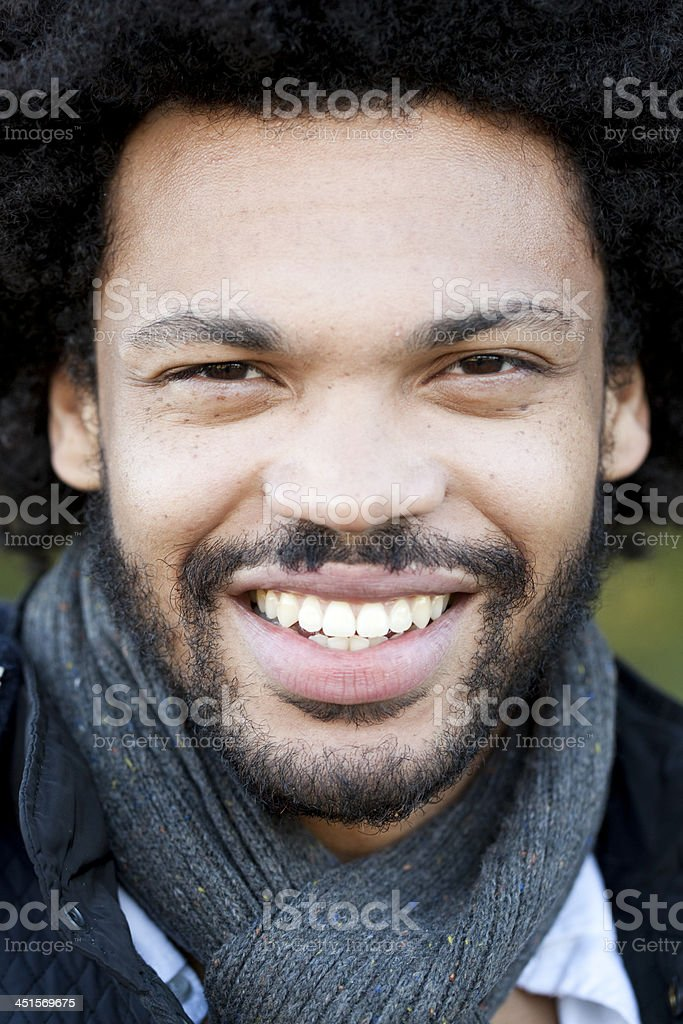 Close up of smiling young adult royalty-free stock photo