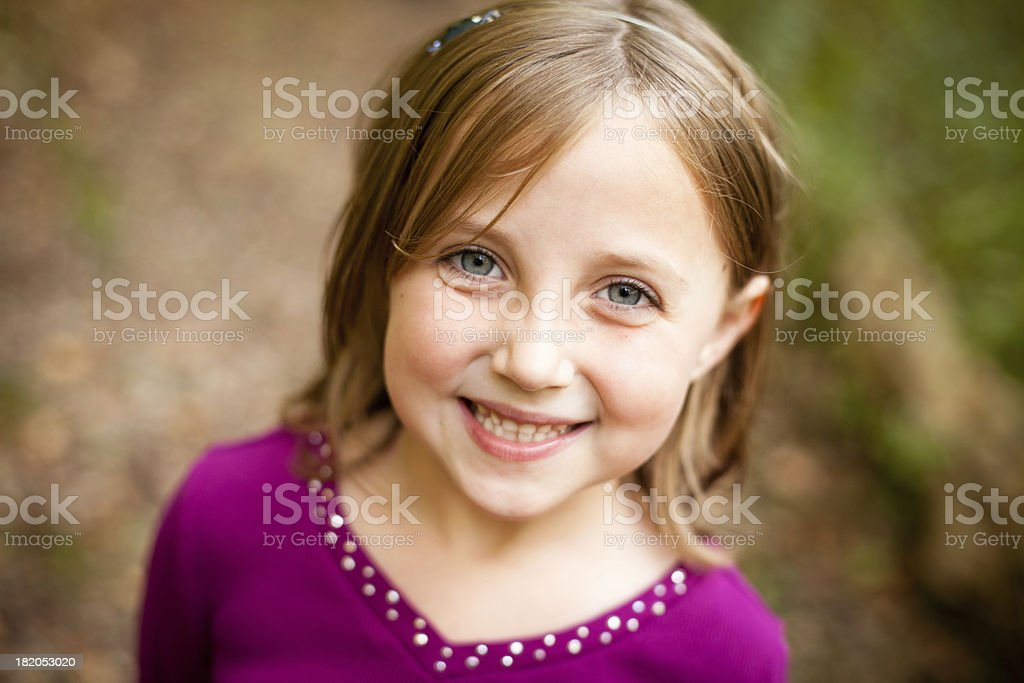 Close Up of Smiling Young Girl, in Outdoor Setting royalty-free stock photo