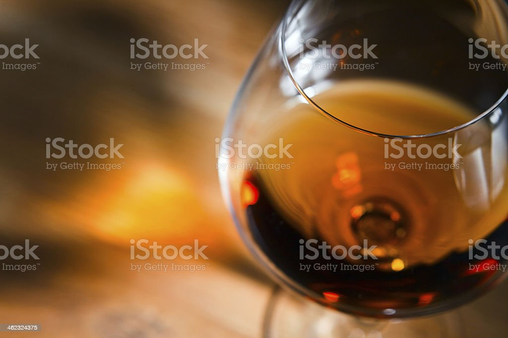 Close up of snifter filled with brandy stock photo