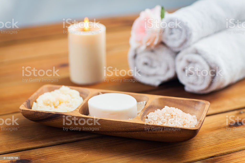 close up of soap, himalayan salt and scrub in bowl stock photo