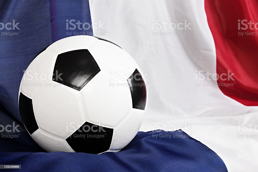 Close up of soccer ball on French national flag stock photo