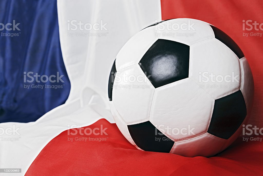 Close up of soccer ball resting on French national flag stock photo