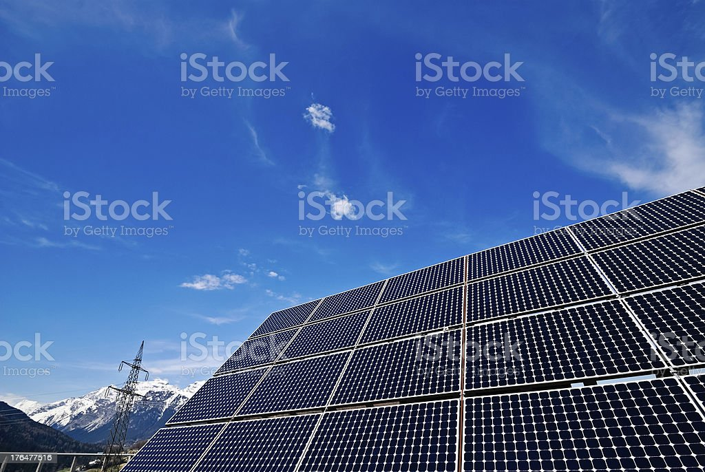 Close up of solar panel with electricity pole stock photo