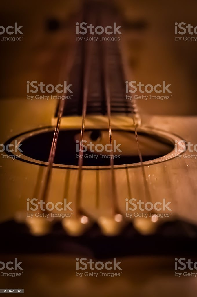 Close up of soundhole of an acoustic guitar stock photo