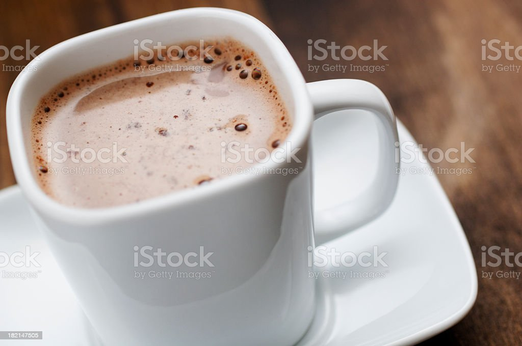 close up of square cup filled with hot chocolate drink stock photo