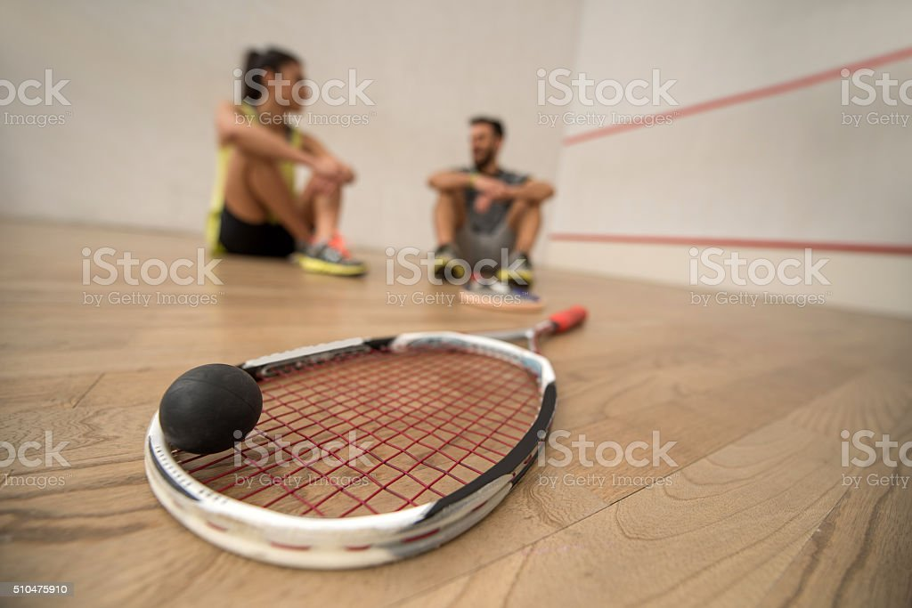 Close up of squash racket and a ball. stock photo