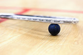 Close up of squash racket and ball