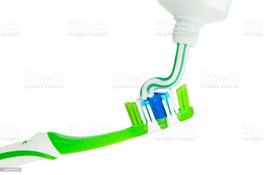 Close up of squeezing toothpaste on toothbrush stock photo