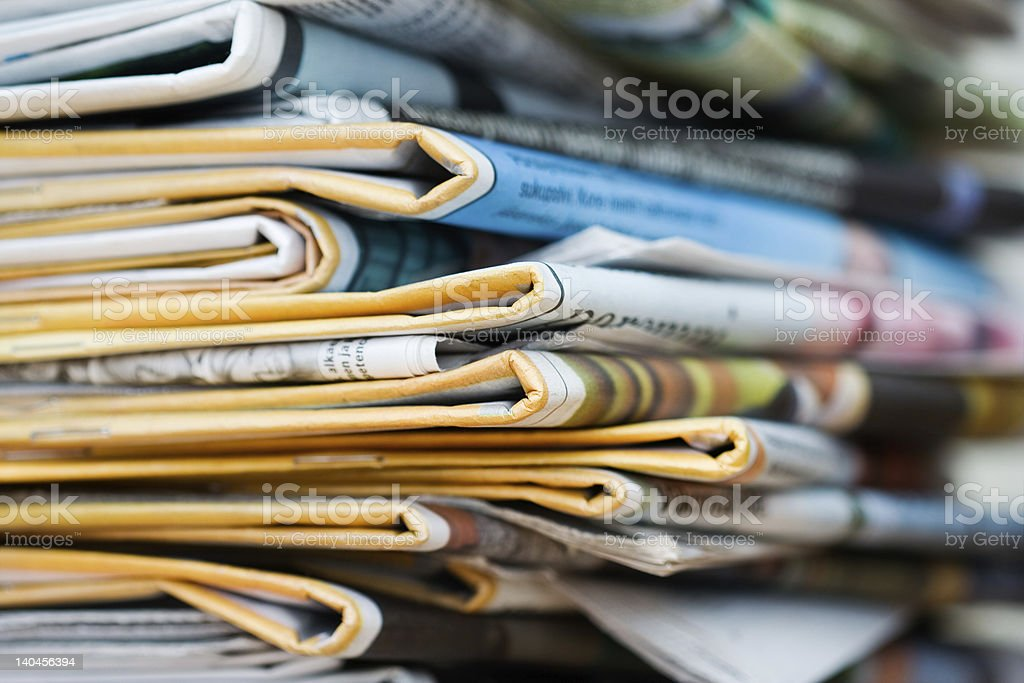 Close up of stack of newspapers royalty-free stock photo