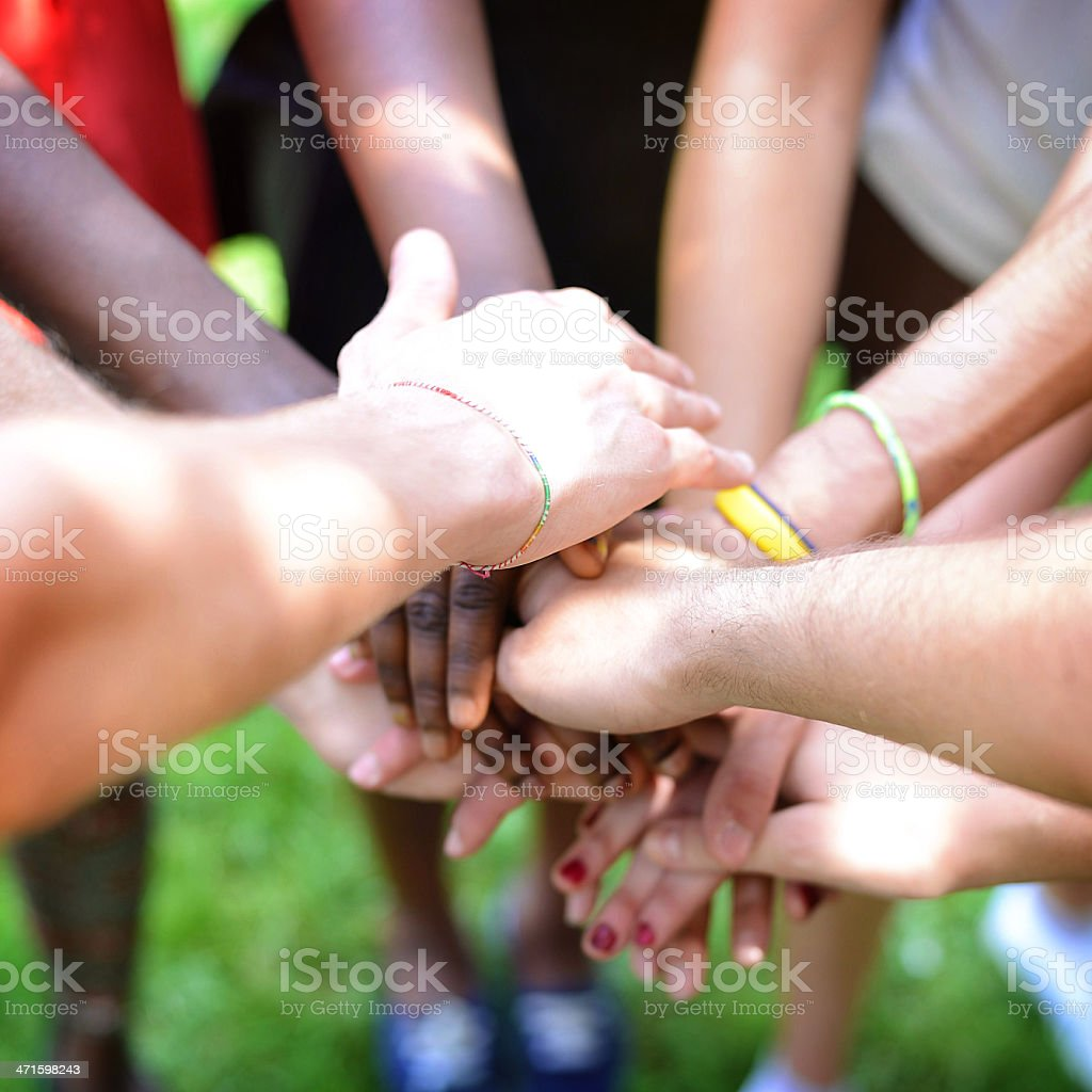 Close up of stacked hands for teamwork royalty-free stock photo