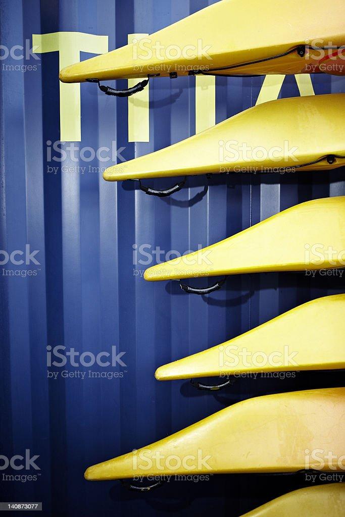Close up of stacked kayaks stock photo