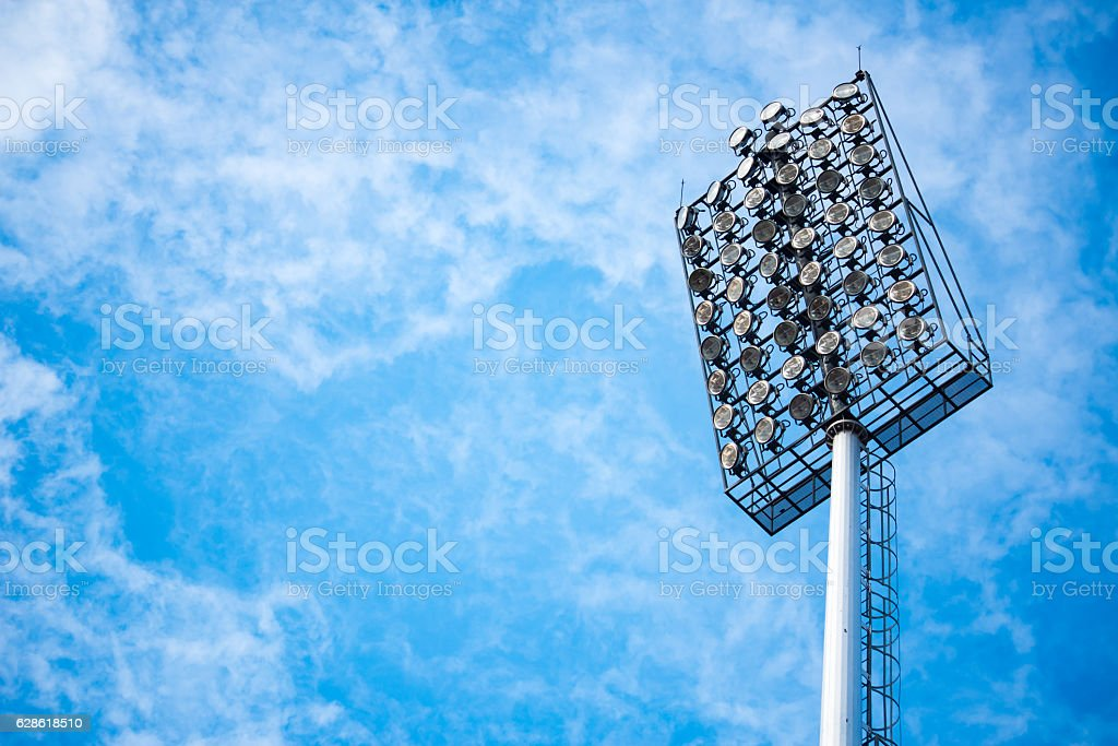 Close up of stadium lights with blue sky backgroud stock photo