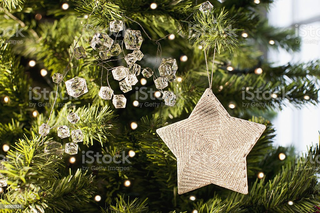 Close up of star ornament on Christmas tree royalty-free stock photo