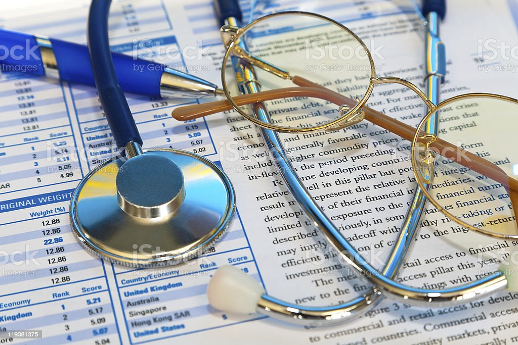 Close up of stethoscope atop medical documents royalty-free stock photo