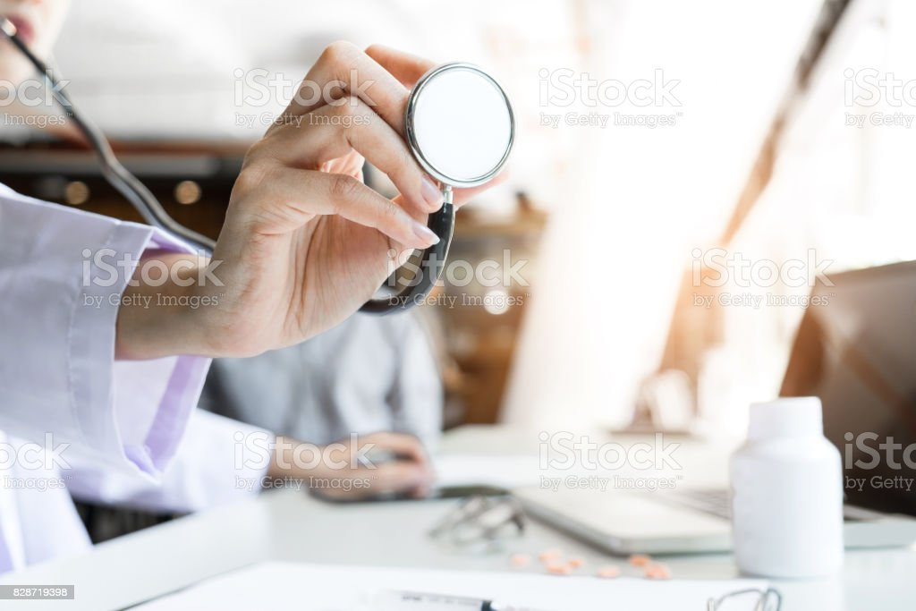 Close up of stethoscope in hand, palm of a doctor cardiologist. Medicine, health hospital equipment for health care, treatment, Healthcare and Medical concept stock photo