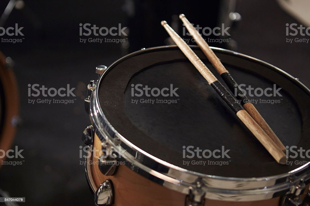 Close Up Of Sticks Resting On Snare Drum stock photo