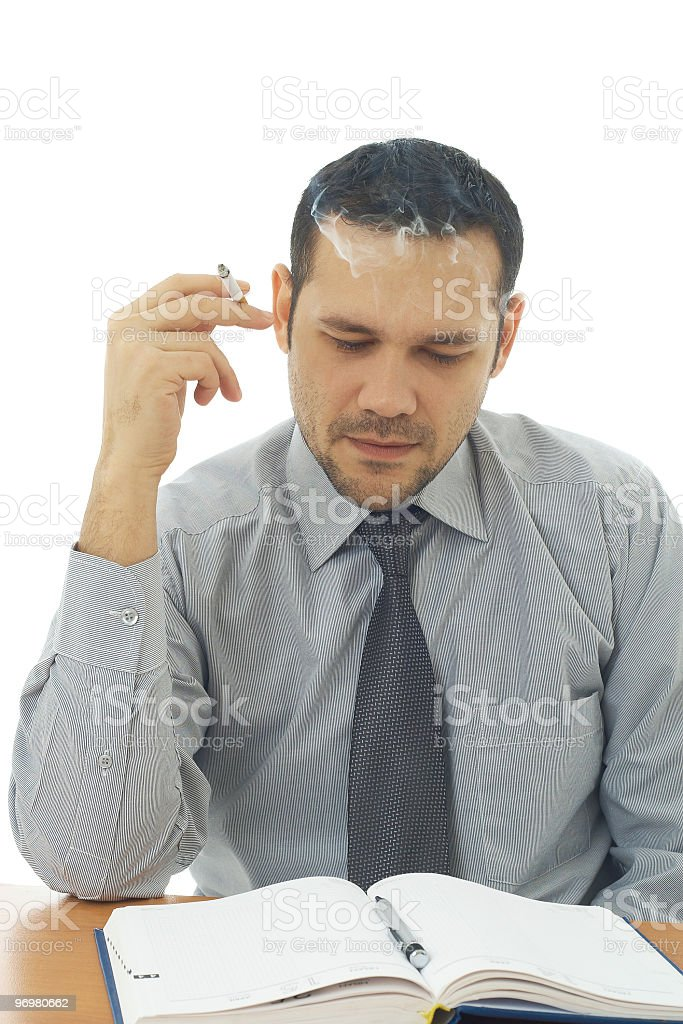 close up of stressed businessman looking to agenda and smoking royalty-free stock photo