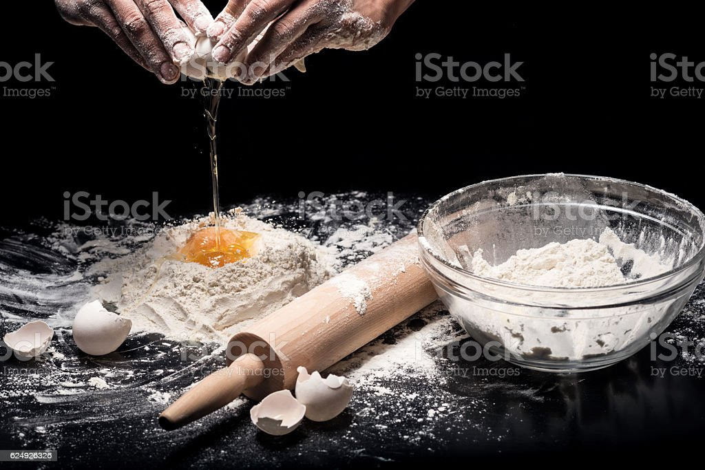 Close up of strong mans hands kneading the dough stock photo