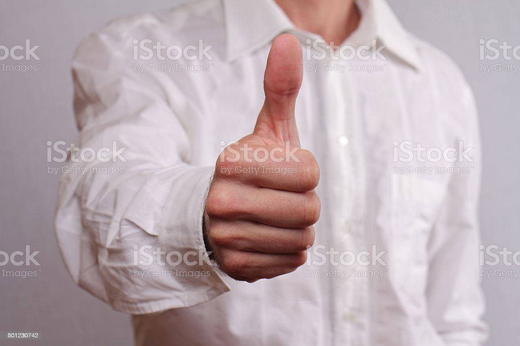 Close up of successfull businessman manager giving thumbs up. stock photo