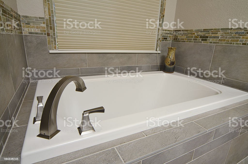 Close up of sunken tub with tile stock photo