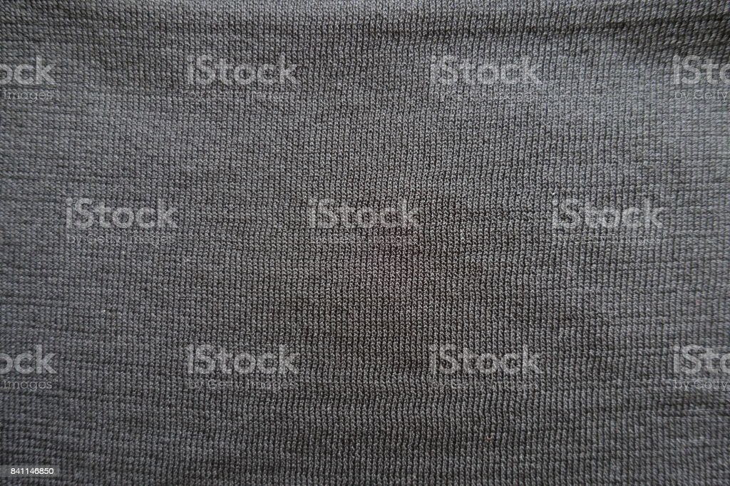 Close up of surface of plain black polyester stockinet stock photo