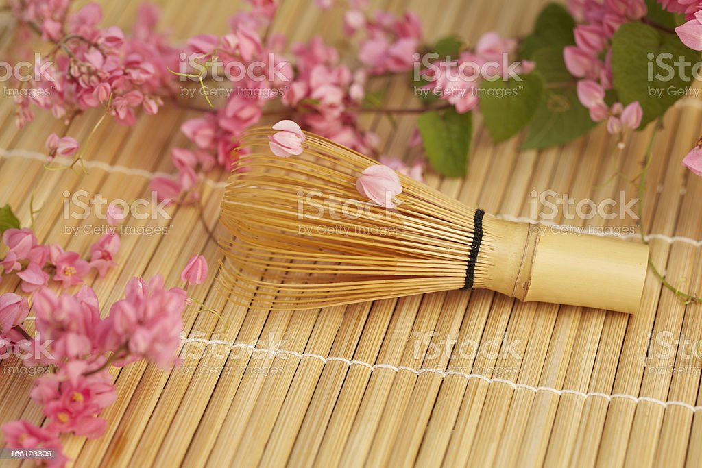 Close up of Tea whisk on bamboo mat. royalty-free stock photo