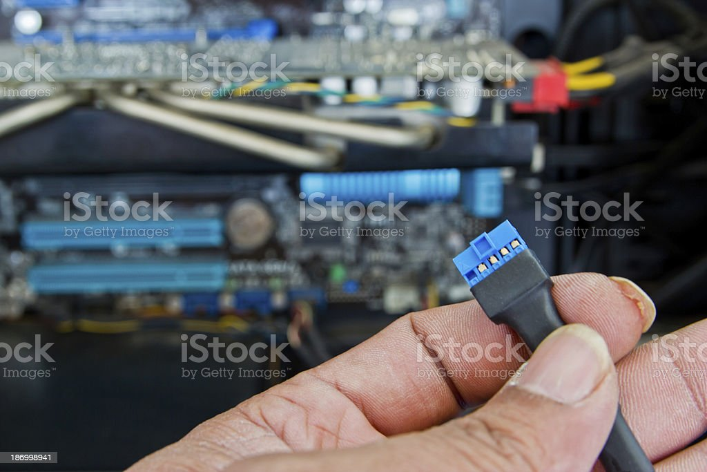 Close up of  technician's hands wiring computer parts royalty-free stock photo