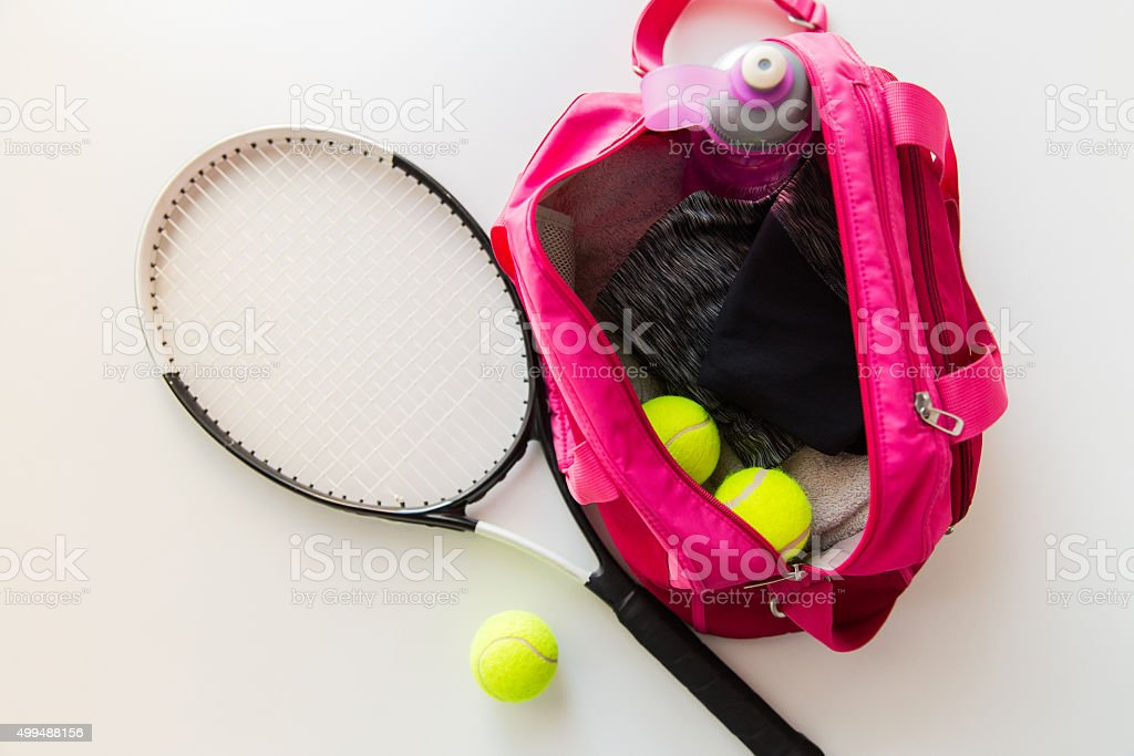 close up of tennis stuff and female sports bag stock photo
