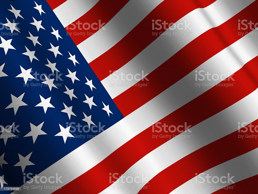 Close up of the American flag as it waves in the wind royalty-free stock photo
