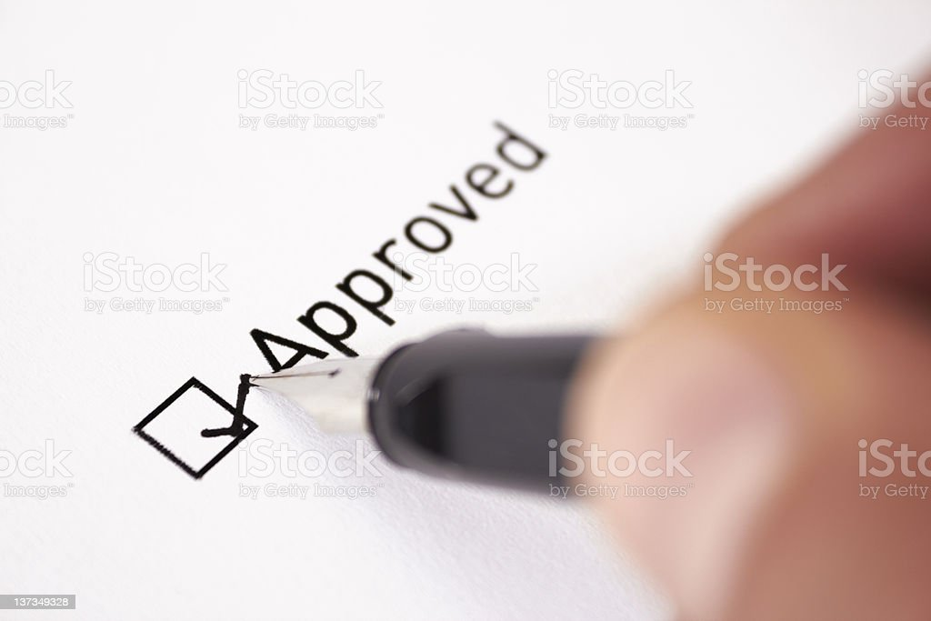 Close up of the approved check box being marked stock photo