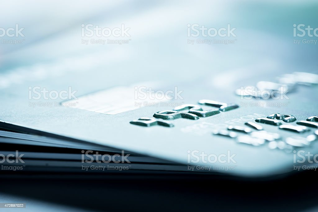 A close up of the beveled numbers on a credit card stock photo