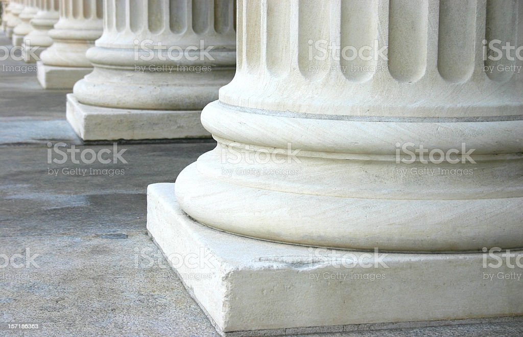 Close up of the bottom of marble columns stock photo