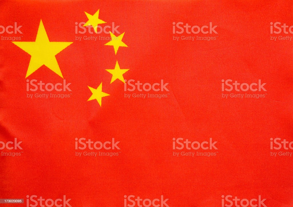A close up of the Chinese flag with its four stars royalty-free stock photo