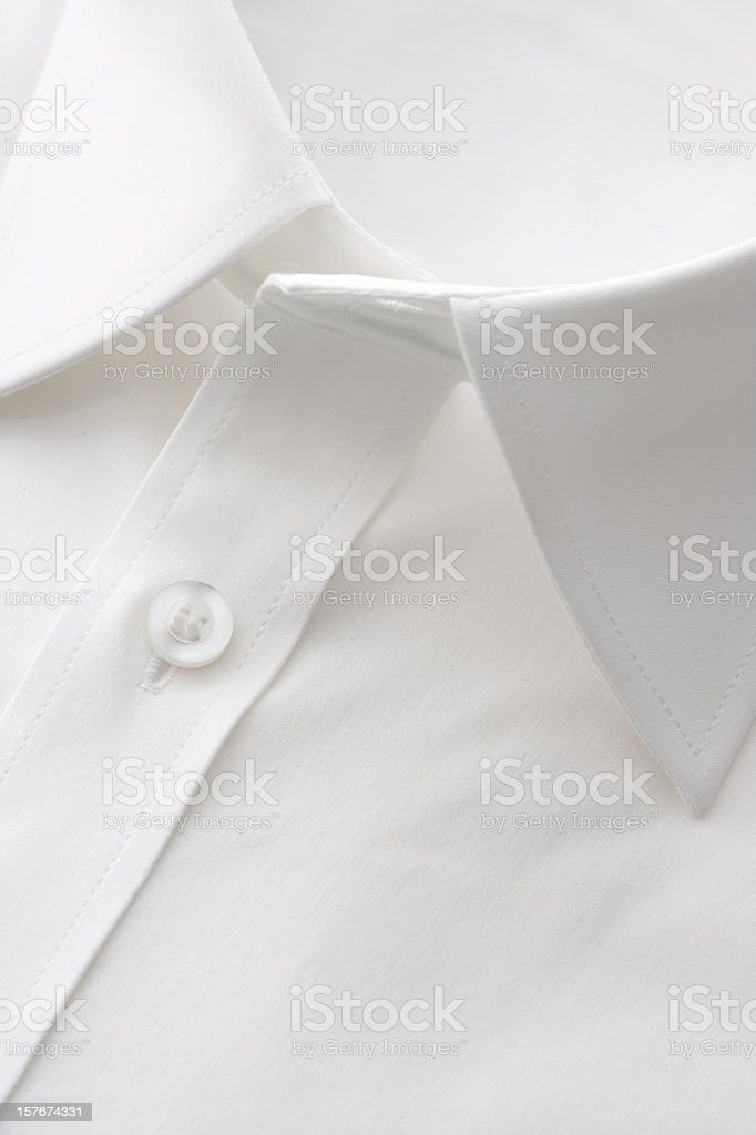 Close up of the collar of a white dress shirt royalty-free stock photo