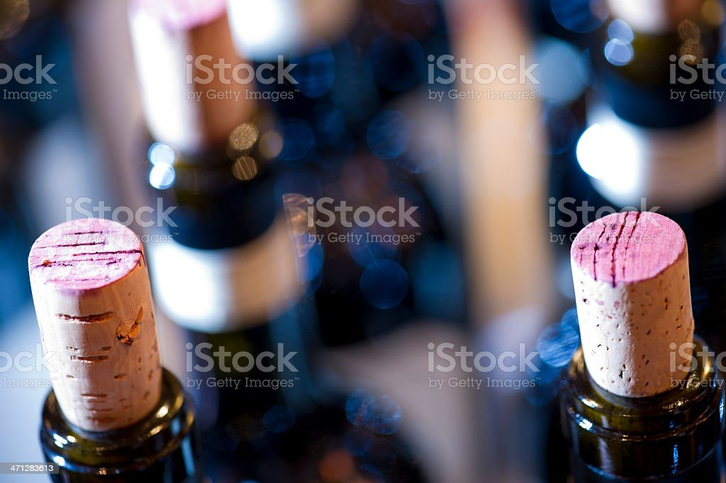 A close up of the corks in red wine bottles stock photo