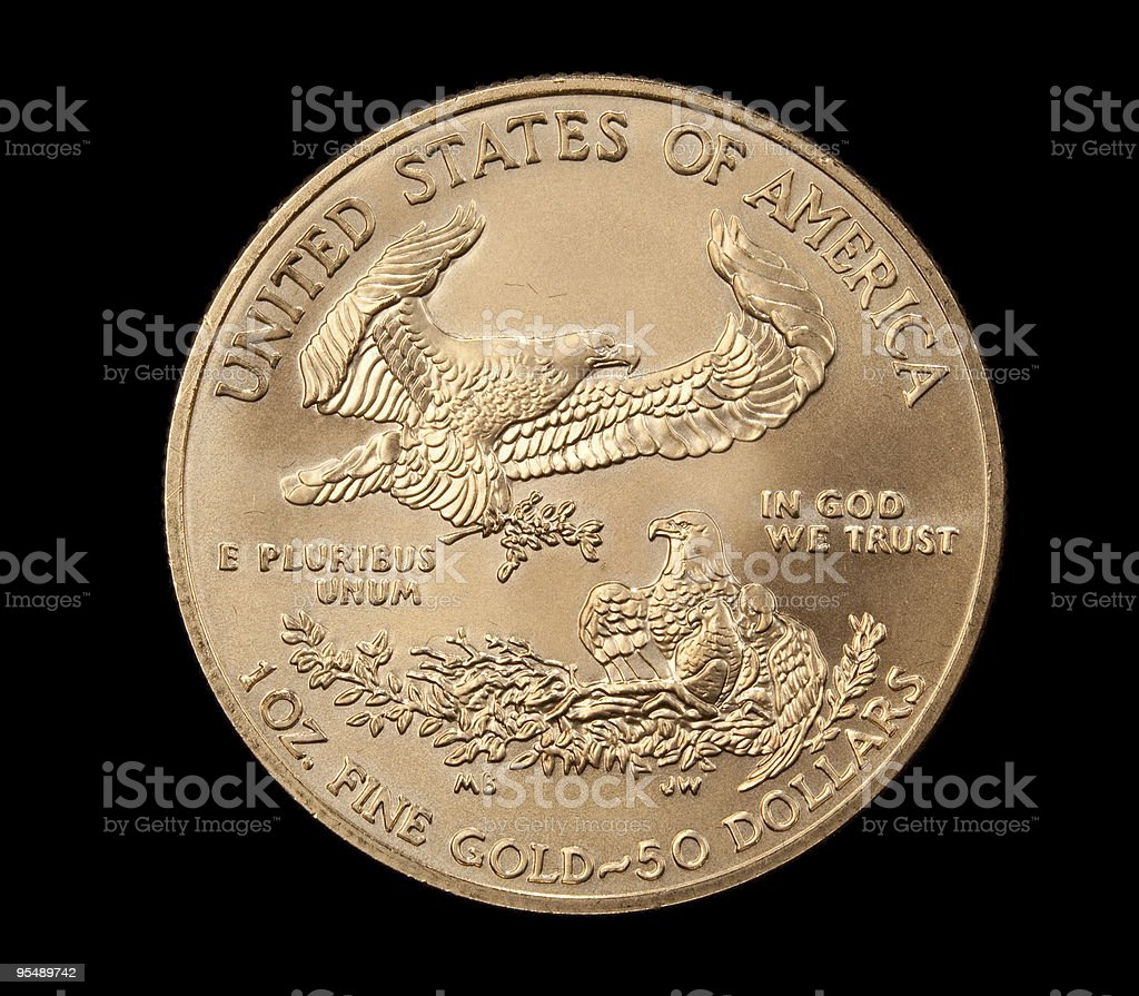 Close up of the Eagle side gold coin stock photo