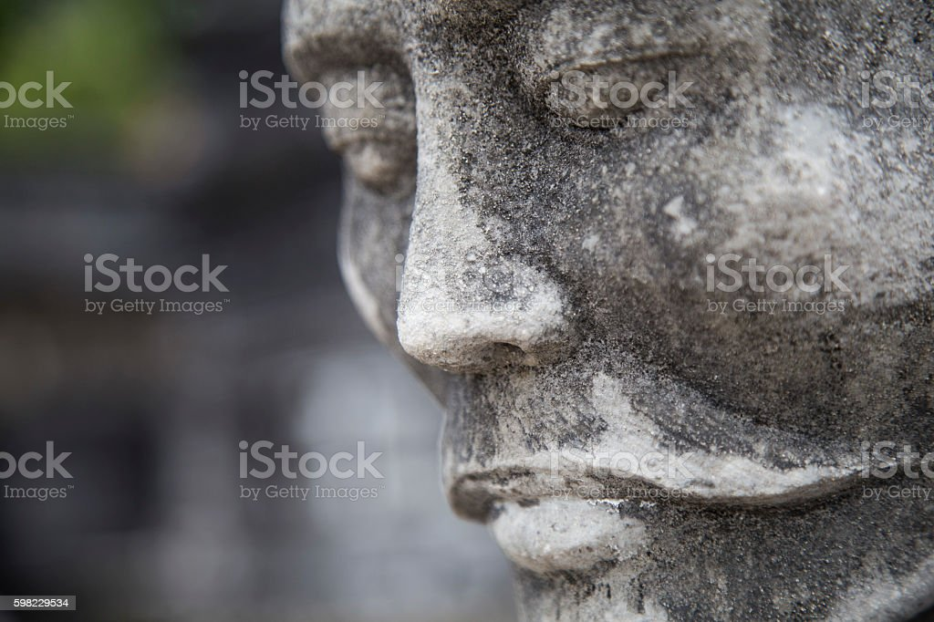 Close up of the face of stone statue stock photo