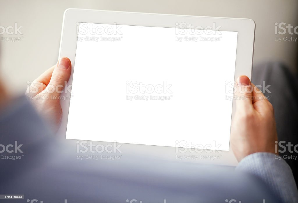 Close up of the hands of a man holding a digital tablet  royalty-free stock photo