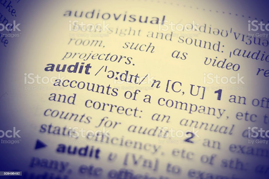 Close up of the word audit from a dictionary stock photo