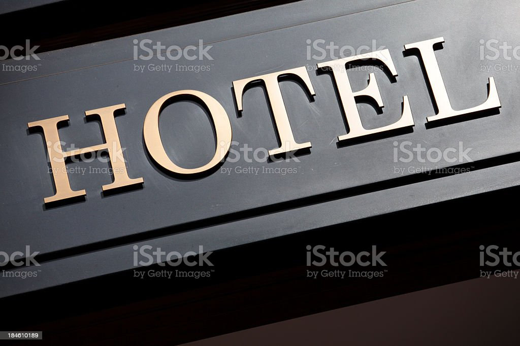 Close up of the word Hotel written in gold on black block  royalty-free stock photo