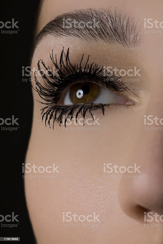 Close Up of Thick Mascara on Beautiful Young Woman's Eyelashes stock photo