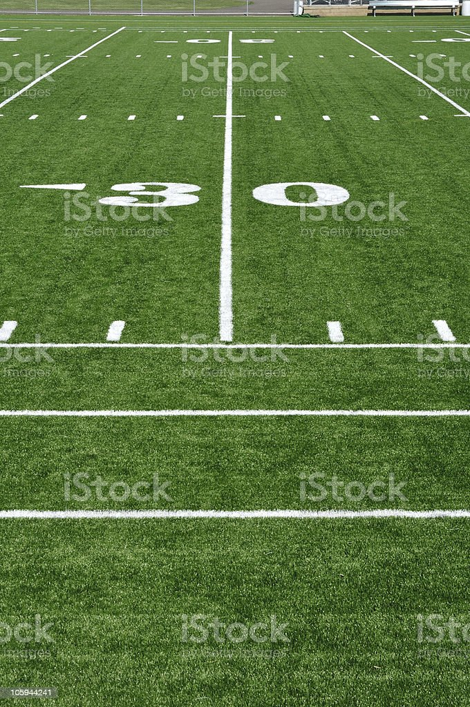 Close up of thirty yard line on football field stock photo