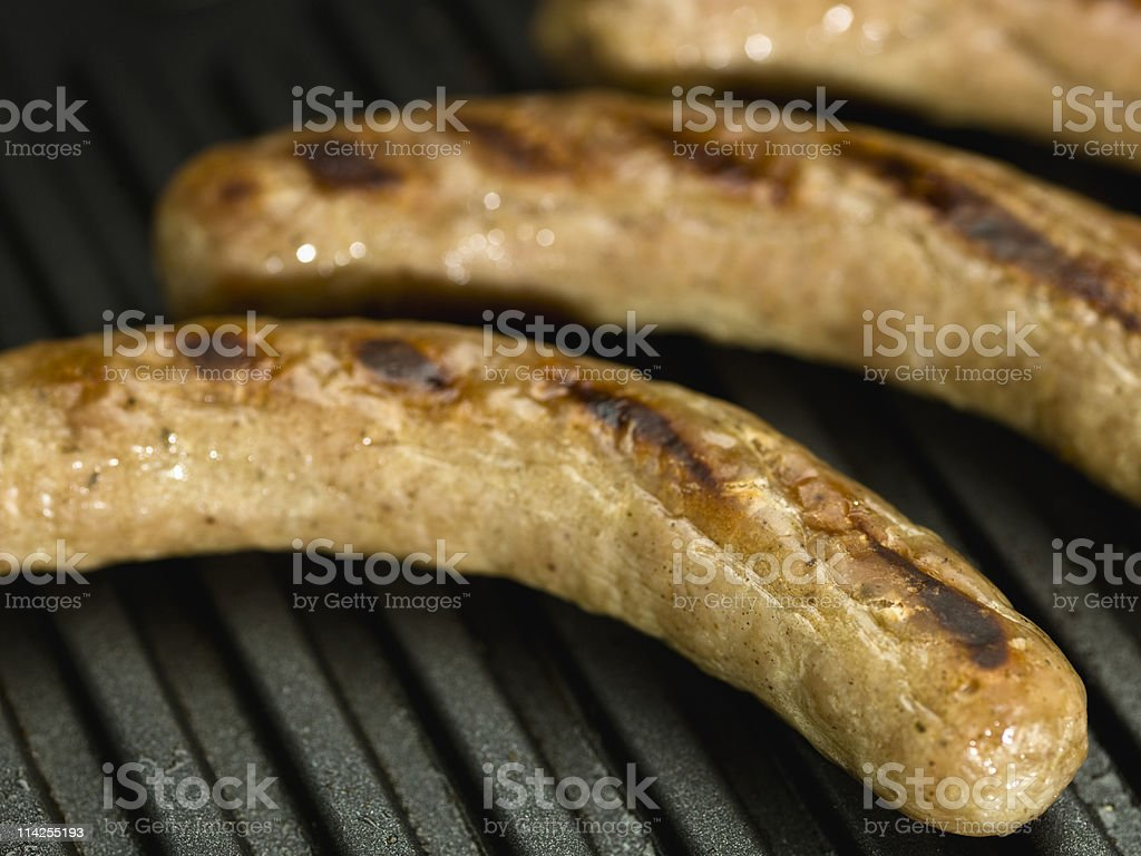 Close up of three morning sausages being grilled. stock photo