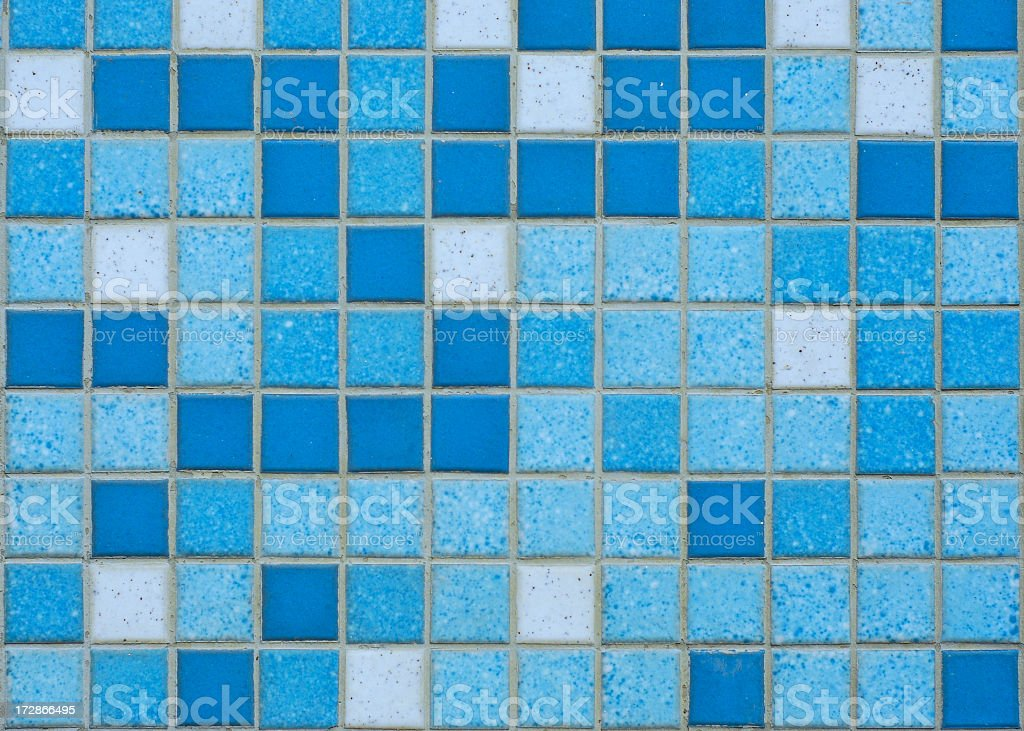 Close up of tile mosaic comprised of varying shades of blue royalty-free stock photo