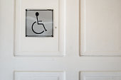 close up of toilet door with disable sign
