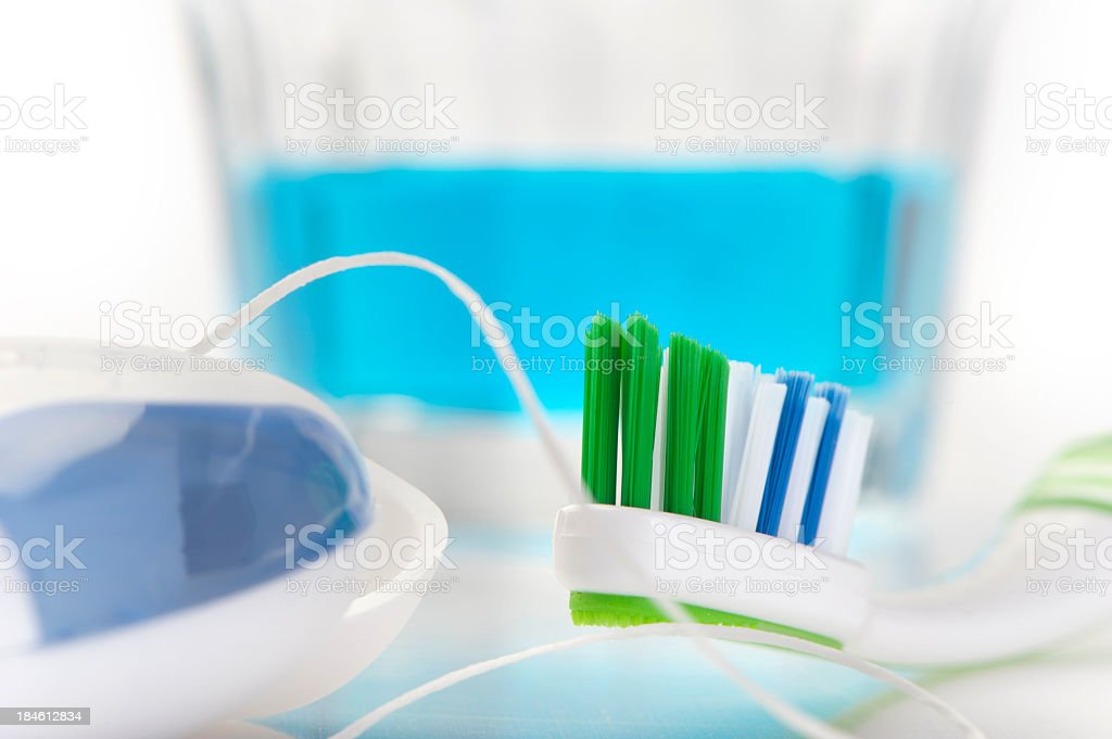 Close up of Toothbrush and dental floss, with mouthwash stock photo