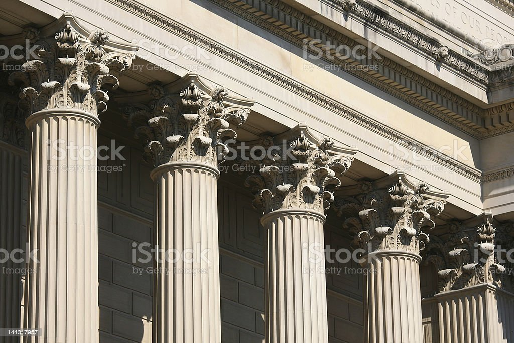 Close up of top of Corinthian columns holding up structure royalty-free stock photo