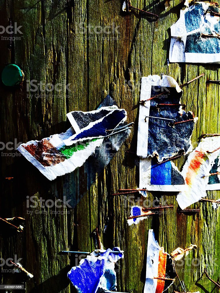 Close up of torn posters on telephone pole royalty-free stock photo