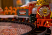 Close up of toy train on train tracks