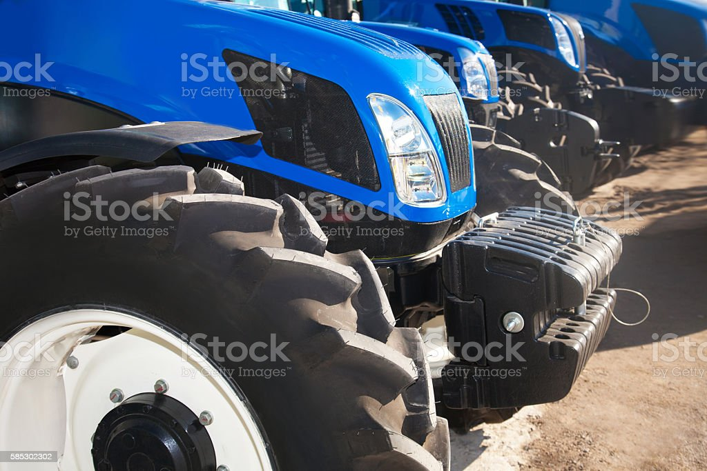Close up of tractors on a row stock photo
